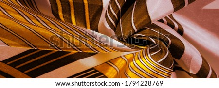 Texture, background, silk fabric with a yellow striped pattern. The design of this fabric is dedicated to a white rabbit mosaic representing the look of a fabulous vest. #1794228769