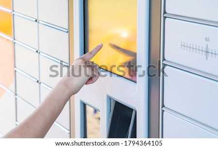 Self service post terminal machine and parcel sending Royalty-Free Stock Photo #1794364105