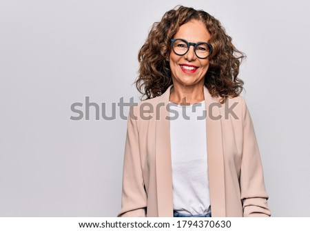 Middle age beautiful businesswoman wearing glasses standing over isolated white background with a happy and cool smile on face. Lucky person. Royalty-Free Stock Photo #1794370630