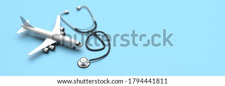 Medical tourism travel for health concept, Plane model and a stethoscope on blue background. Health care insurance template, copy space, banner. 3d illustration