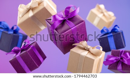 Gifts in flying boxes, wrapped in blue, purple and kraft paper with bow on lilac background. Sale, discounts. Royalty-Free Stock Photo #1794462703