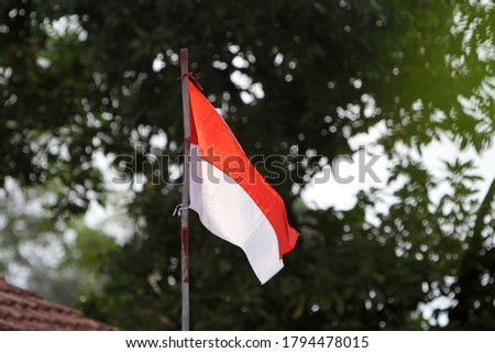 Indonesian flag on the flagpole. Bendera Indonesia on the flagpole. Indonesian Independence Day with Red and White flag. Indonesian flag, red and white #1794478015