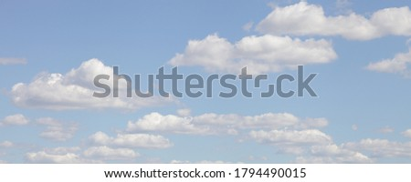 Beautiful blue sky with Cumulus clouds panorama on Sunny summer day, stratosphere view background texture Royalty-Free Stock Photo #1794490015