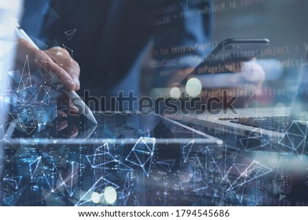 Business technology, digital software development, IoT concept. Man programmer, software developer working on digital tablet computer and smart city with polygon, html computer code on virtual screen