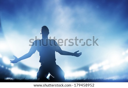 Football, soccer match. A player celebrating goal, victory. Lights on the stadium at night. Royalty-Free Stock Photo #179458952