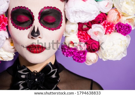 Closeup photo of voodoo alive awake dead witch closed eyes religion ritual folklore creature face print katrina scary makeup wear floral headwear band black costume isolated purple background