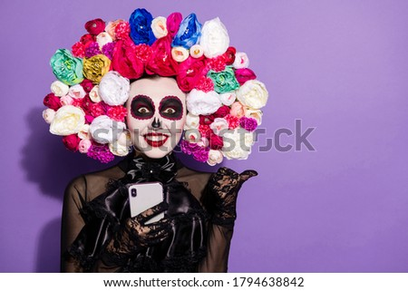 Photo crazy funky dead bride demon witch lady face paint print telephone blogging direct finger empty space mexican culture floral headband black costume isolated purple violet color background Royalty-Free Stock Photo #1794638842