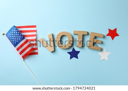 American flag, word Vote and stars on blue background