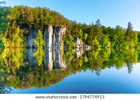 Sandstone rock towers reflected in Vezak Pond, Czech: Vezicky rybnik, Bohemian Paradise, Czech: Cesky Raj, Czech Republic. #1794774913