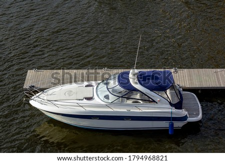 Pier speedboat. A marina lot. Yacht is moored at the quay. Marine parking of modern motor boats. Relaxation and fashionable vacation. Boats At The Marina. Top view. Royalty-Free Stock Photo #1794968821