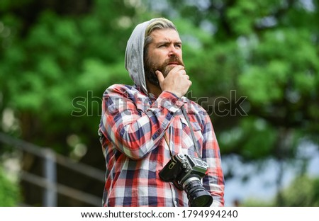 Carefree time. brutal man traveler with retro camera. photography in modern life. travel tips. professional photographer use vintage camera. bearded man hipster take photo. photo shooting outdoor.