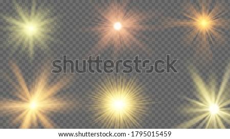 Sun ray effect. Starburst yellow shine, sunlight radiance on transparent background. Sunshine beams, summer sunbeam vector set. Illustration sun star light, effect burst, flare and bright starburst #1795015459