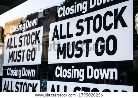 CLOSING DOWN ALL STOCK MUST GO signs in a shop window: UK officially in recession for first time in 11 years Royalty-Free Stock Photo #1795020256