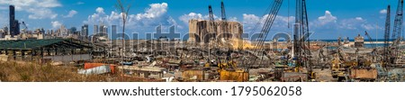 Panoramic photo of Beirut Port / Explosion Site with Beirut Skyscrapers appearing in the background Royalty-Free Stock Photo #1795062058