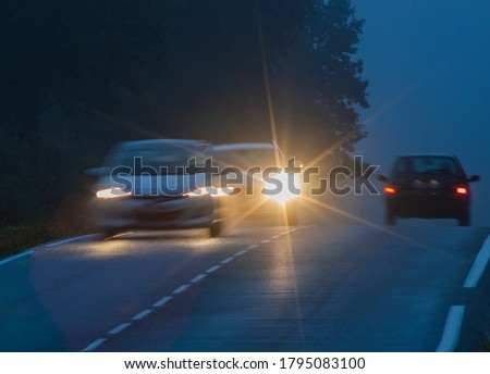 Car with incorrectly adjusted headlights starts to overtake motion blur #1795083100