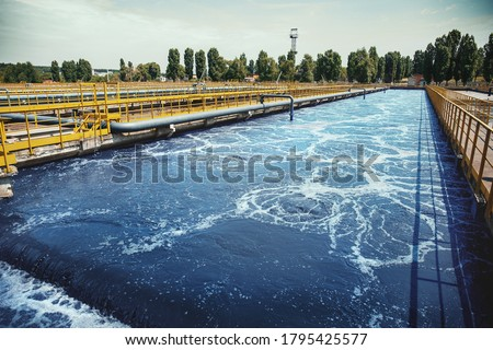 Wastewater treatment plant. Reservoir for purification of sewage. Royalty-Free Stock Photo #1795425577