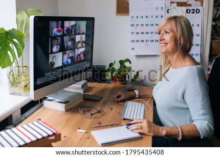 Smiling mature woman having video call via computer in the home office. Online team meeting video conference calling from home. Attractive Businesswoman Telework. Business video conferencing.  #1795435408