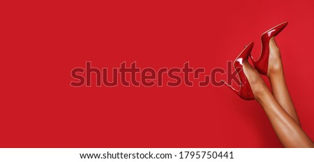Female feet with red high heels on. Studio shoot.  Royalty-Free Stock Photo #1795750441