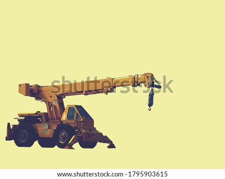 Construction backhoe with a pale yellow background