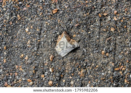 Dark texture of various stones and rubble. Background, close-up. Royalty-Free Stock Photo #1795982206