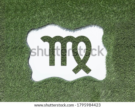 Zodiac signs in the form of a pattern from the grass on the lawn