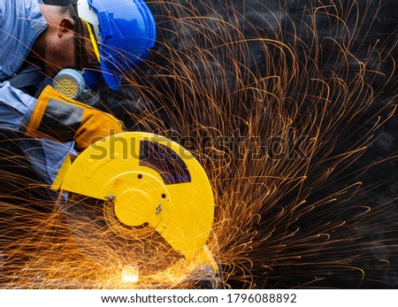 Technicians engineering skill carpentry uses tape measure meters wearing blue protective clothing are cutting off industrial factory steel electric wheels pipe