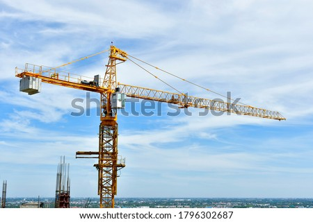 The Crane tower in construction  site of a high-rise condominium. Royalty-Free Stock Photo #1796302687