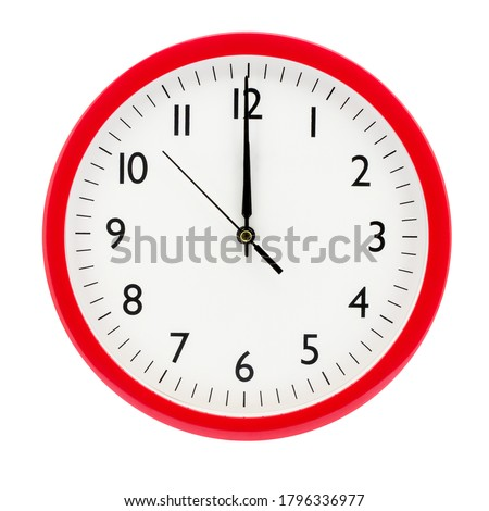 Clock on a white isolated background shows 12 o'clock on New Year's Eve #1796336977