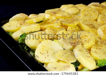 Raw french potatoes with vegetable #179645381