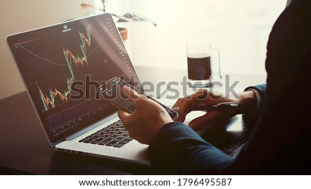 investment stockbroker profit analysis. Stock trading graph price prediction and profit gain. Trade graph chart bitcoin. Financial manager workplace desk  Royalty-Free Stock Photo #1796495587