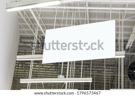 Blank White Supermarket Banners Hanging From Ceiling. Hangers Mockup Ready For Branding Or Advertising.