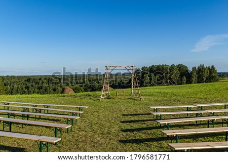 A view of the sets before a countryside wedding. Picture was taken in Latvia, Latgale. Latvian wedding usually happen during the summer time. Weeding out doors.