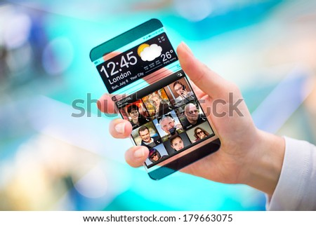 Smart phone (phablet) with a transparent display in human hands. Concept actual future innovative ideas and best technologies humanity. #179663075