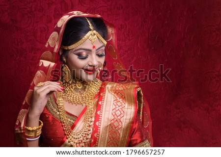 Portrait of Indian Model in Bridal Makeup look. Traditional Indian wedding bridal makeup and Gold Jewelry. #1796657257