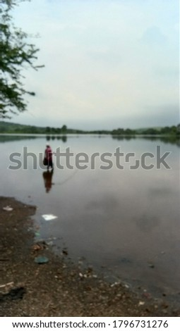 Blur Picture of Fisherman fishing near the Sea,  River or lake.  Intentionally Blurred picture.