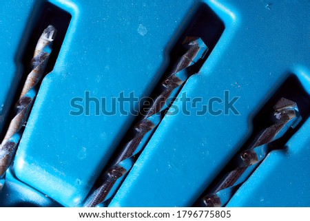 drill inserted in a blue case. stock photo.  #1796775805