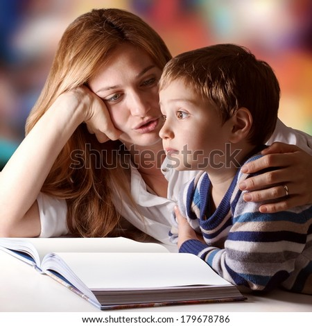 Little boy listening to his mother telling him stories #179678786