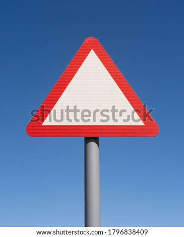 Blank triangle warning road sign with blue sky background. Hertfordshire. UK