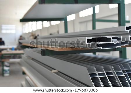 Steel factory warehouse displayed aluminum profile for window, door, bathroom box   Royalty-Free Stock Photo #1796873386