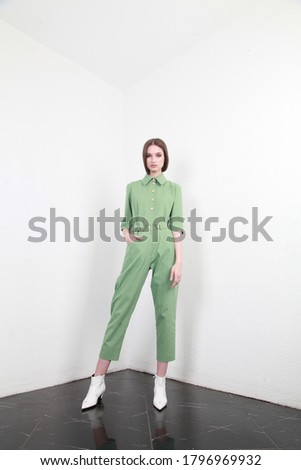 Fashion model beautiful woman wear casual style clothing for every day, light green cotton suit summer collection with white wall background studio accessory luxury.