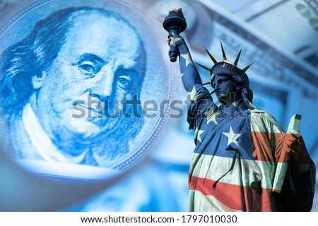 USA economy. Financial. Franklin's portrait next to statue of liberty. Statue of Liberty is painted in colors of the USA flag. Federal Reserve System of America. Concept - financial forecast for  USA #1797010030
