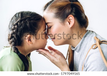 Portrait of enjoy happy love asian family mother and little asian girls child smiling and having fun touching face with cute kid daughter moments good time