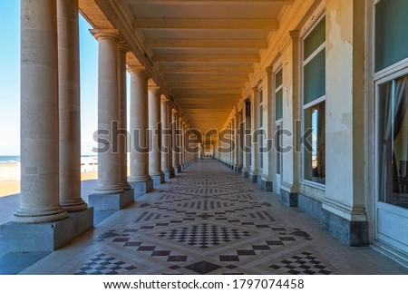 The waterfront promenade in Oostende (Ostend) by the beach and North Sea in summer, Belgium. Royalty-Free Stock Photo #1797074458