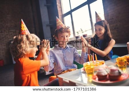 Bday. Three kids celebrating bday and feeling happy