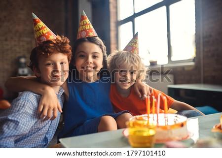 Celebration. Three kids celebrating bday and looking happy