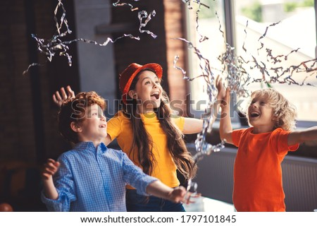 Bday. Three cute kids celebrating bithday and enjoying