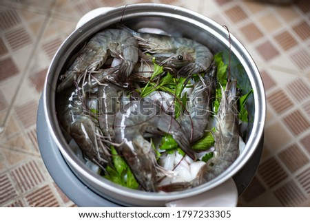 Cooking shrimp or prawn and squid in pot steam in kitchen. Seafood menu. Selective focus. Soft picture