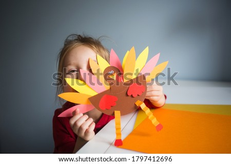 paper craft for kids. DIY Turkey made for thanksgiving day. create art for children. girl playing with a toy. #1797412696