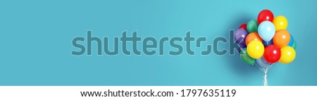 Bunch of bright balloons on light blue background, space for text. Banner design