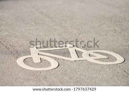 Bicycle sign on road. Bike lane sign - only bikes allowed. Road marking on park asphalt Royalty-Free Stock Photo #1797637429